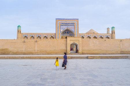 muhammad: The Muhammad Rahim-khan Madrasah behind the high brick wall, Khiva, Uzbekistan.