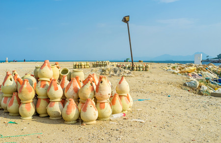 september 2: CARTHAGE, TUNISIA - SEPTEMBER 2, 2015: The earthenware pots for catching octopuses get dry in the sun, on September 2 in Carthage.