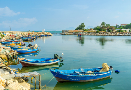 september 2: CARTHAGE, TUNISIA - SEPTEMBER 2, 2015: The numerous scenic boats in historical punic port, on September 2 in Carthage.