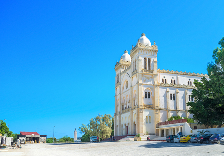 september 2: CARTHAGE, TUNISIA - SEPTEMBER 2, 2015: The old catholic cathedral next to the entrance to the museum of Carthage, on September 2 in Carthage.
