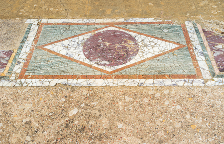september 2: CARTHAGE, TUNISIA - SEPTEMBER 2, 2015: The colorful geometric pattern of the stone tiles in archaeologcal site of the Roman villas, on September 2 in Carthage. Editorial