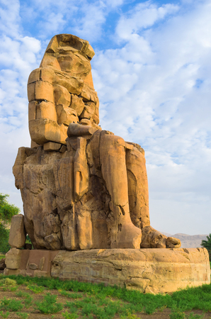 quartzite: One of the huge Colossus, located on the West bank of Nile river in the ancient Necropolis, Luxor, Egypt. Stock Photo