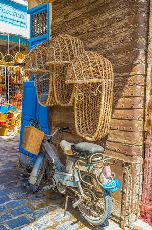 bab: SFAX, TUNISIA - SEPTEMBER 3, 2015: The wicker baby carriages in the market stall next to Bab Diwan Gates, on September 3 in Sfax. Editorial