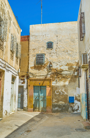 slums: SFAX, TUNISIA - SEPTEMBER 3, 2015: Some neighborhoods of Medina consist of the slums, that are the oldest buildings in town, on September 3 in Sfax.