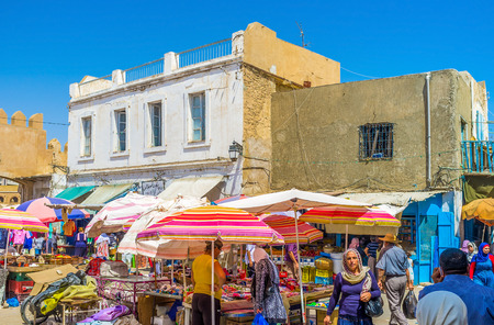 bab: SFAX, TUNISIA - SEPTEMBER 3, 2015: The traditional busy arabic souq (market) located just outside the Bab Jebli gates, on September 3 in Sfax. Editorial