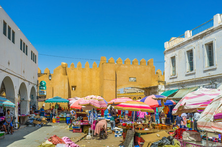bab: SFAX, TUNISIA - SEPTEMBER 3, 2015: The souq at Bab Jebli gates isnt tourist destination, so its radically different from neat and clean resort markets, on September 3 in Sfax.