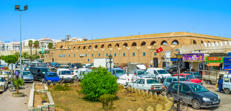 manufactured: SFAX, TUNISIA - SEPTEMBER 3, 2015: The building of manufactured goods market surrounded by large chaotic parking, on September 3 in Sfax. Editorial
