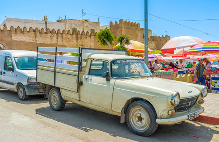 bab: SFAX, TUNISIA - SEPTEMBER 3, 2015: The old pickup parked at the souq, located at Bab Jebli gates, on September 3 in Sfax.