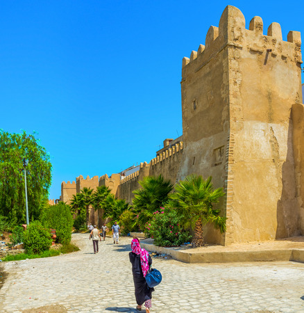 best way: SFAX, TUNISIA - SEPTEMBER 3, 2015: The shady park along the town walls is the best way to hide from the midday sun, on September 3 in Sfax.