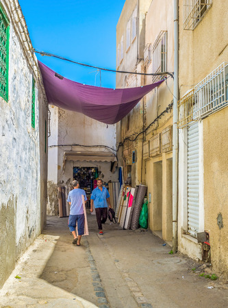 specializes: SFAX, TUNISIA - SEPTEMBER 3, 2015: The quarter in old Medina specializes on selling draperies to the cloth manufactures, on September 3 in Sfax. Editorial