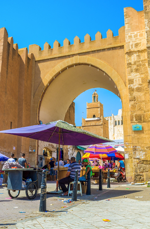 bab: SFAX, TUNISIA - SEPTEMBER 3, 2015: The roaring trade next to the Bab Divan Gates, on September 3 in Sfax.