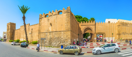 bab: SFAX, TUNISIA - SEPTEMBER 3, 2015: The  huge towers next to the Bab El Kasbah Gates, the crowded entrance to the Medina, on September 3 in Sfax.