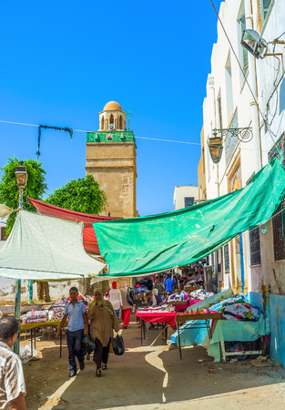 second hand: SFAX, TUNISIA - SEPTEMBER 3, 2015: The giant second hand market in Medina next to Bab El Kasbah Gates, on September 3 in Sfax.