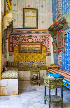 interrior: SOUSSE, TUNISIA - SEPTEMBER 3, 2015: The scenic interrior  of tea room decorated with glazed tiles in Dar Essid mansion, on September 3 in Sousse.