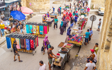 spontaneous: SOUSSE, TUNISIA - SEPTEMBER 6, 2015: The central streets of Sousse are often occypied by spontaneous market, on September 6 in Sousse.