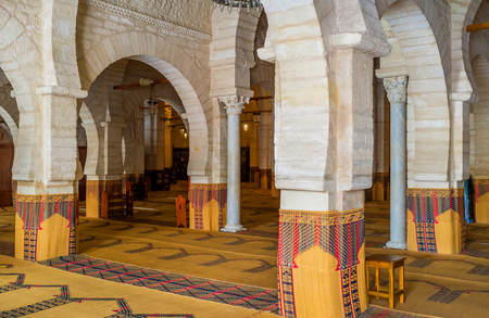 arcades: SOUSSE, TUNISIA - SEPTEMBER 6, 2015: The interior of the Grand Mosque with many rows of stone arcades and ancient columns, on September 6 in Sousse.