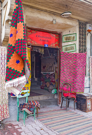 konya: KONYA, TURKEY - JANUARY 20, 2015: The entrance to the antique shop with beautiful hand made vintage carpets, on January 20 in Konya. Editorial