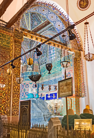 KONYA, TURKEY - JANUARY 20, 2015: The walls in burial chamber of Mevlana Mausoleum decorated with colorful islamic patterns and old calligraphy, on January 20 in Konya. Editorial