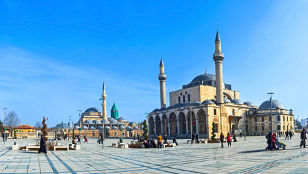 selimiye mosque: KONYA, TURKEY - JANUARY 20, 2015: The  central square of the old town with the Mevlana Museum on the background and Selimiye Mosque, on January 20 in Konya. Editorial