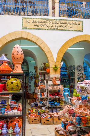 reminding: SOUSSE, TUNISIA - SEPTEMBER 6, 2015: The local pottery is the nice gift and reminding about vacation, on September 6 in Sousse. Editorial