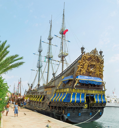 ornamentations: SOUSSE, TUNISIA - SEPTEMBER 6, 2015: The wooden stern of the pirate galleon decorated with carved sculptures and ornamentations, on September 6 in Sousse. Editorial
