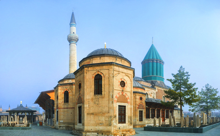 The Mevlana Mausoleum with the green dome, covered with turquoise faience is the symbol of Konya, Turkey.