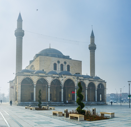 selimiye mosque: KONYA, TURKEY - JANUARY 20, 2015: The foggy winter weather in Konya with the view on Selimiye Mosque, on January 20 in Konya. Editorial