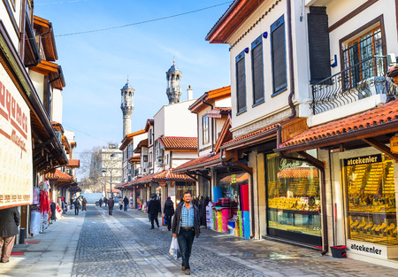 seljuk: KONYA, TURKEY - JANUARY 20, 2015: The restored market in the old town boasts the long golden street with the numerous jewellery shops, on January 20 in Konya.