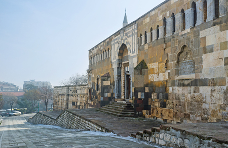 seljuk: The stone gates, leading to the Sultan Turbes, decorated with geometric ornamentation of white and grey stone, Konya, Turkey. Stock Photo