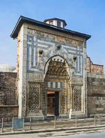 seljuk: The carved stone gates of Karatay Madrasah decorated with geometric patterns in islamic style, Konya, Turkey. Stock Photo