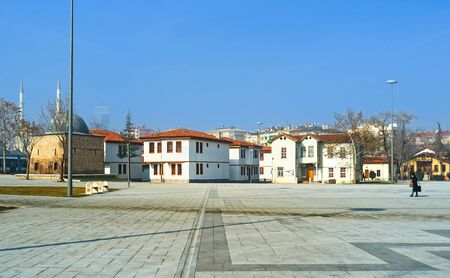 konya: KONYA, TURKEY - JANUARY 20, 2015: The old typical housing was preserved in the central districts of the town, with the tiny Sifahane (Sakahane) Mosque from the left, on January 20 in Konya. Editorial