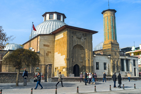KONYA, TURKEY - JANUARY 20, 2015: The Ince Minaret Madrasah decorated with the islamic patterns of the carved stone, using the calligraphy, geometric ornaments and vertical ribbon-like lines on minaret, on January 20 in Konya. Editöryel