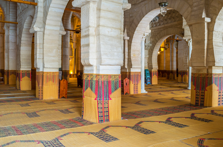 prayer rug: SOUSSE, TUNISIA - SEPTEMBER 6, 2015: The medieval stone prayer hall with many rows separated by arcades in Grand Mosque, on September 6 in Sousse.