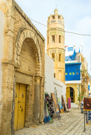 octogonal: SOUSSE, TUNISIA - SEPTEMBER 6, 2015: The old tiny mosque with the scenic octagonal minaret, decorated with glazed tiles, on September 6 in Sousse. Editorial