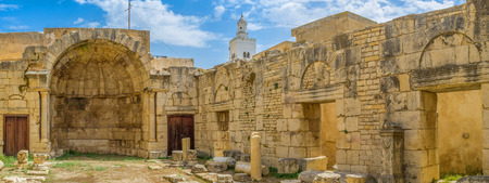 st  peter: The ancient ruins of St Peter church with preserved apse and some walls, with bright blue sky instead of the dome, Le Kef, Tunisia. Stock Photo