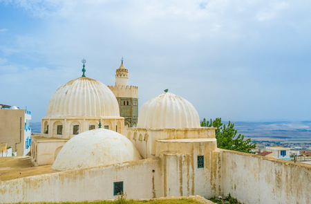 arabic architecture: The Mosque of Sidi Abdallah Boumakhlouf is the fine example of arabic architecture, decorated with beautiful ribbed domes and colorful glazed tiles on the minaret, El Kef, Tunisia.