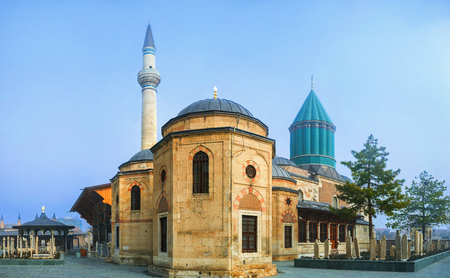 konya: The Mevlana Mausoleum with the green dome, covered with turquoise faience is the symbol of Konya, Turkey.