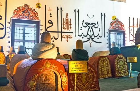 sufi: KONYA, TURKEY - JANUARY 20, 2015: The medieval sarcophagi in Mevlana Museum decorated with embroidered islamic patterns and turbans, on January 20 in Konya. Editorial