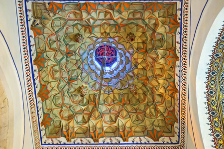 KONYA, TURKEY - JANUARY 20, 2015: The colorful relief ceiling in Mevlana Mausoleum, on January 20 in Konya.