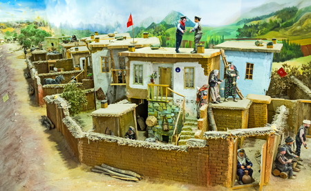 diorama: KONYA, TURKEY - JANUARY 20, 2015: The diorama of the rural life with the miniature figures of people and village street, on January 20 in Konya.