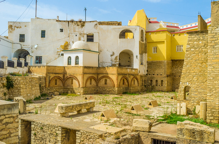 archaeological site: The small archaeological site of Roman Cisterns is sandwiched between the high residential buildings of the old neighborhood, El Kef, Tunisia.