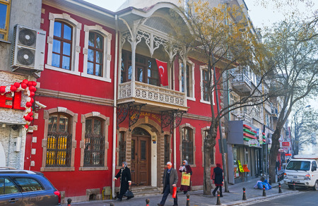 konya: KONYA, TURKEY - JANUARY 20, 2015: The scenic red mansion in old neighborhood, on January 20 in Konya. Editorial