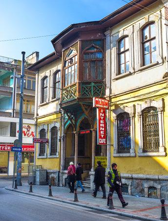 seljuk: KONYA, TURKEY - JANUARY 20, 2015: The old building with beautiful wooden balcony, located in old shopping neighborhood, on January 20 in Konya. Editorial