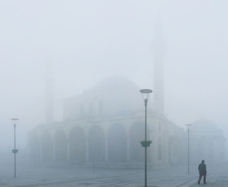 The Selimiye Mosque covered by the hard winter mist, Konya, Turkey.