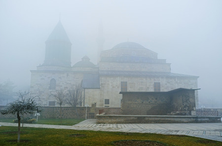 konya: The silhouette of Mevlana Museum through the hard winter mist, Konya, Turkey. Editorial