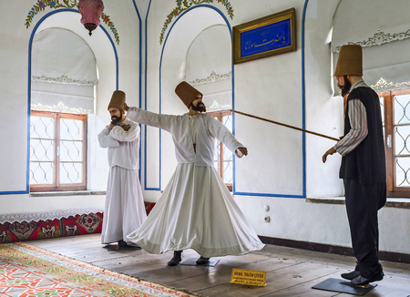 KONYA, TURKEY - JANUARY 20, 2015: The mannequins of dervishes in Mevlana Museum depict the ceremony of ritual dervish whirling dance, an active meditation, on January 20 in Konya.