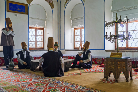 depict: KONYA, TURKEY - JANUARY 20, 2015: The mannequins of dervishes in Mevlana Museum depict the scene from everyday life of the members of the order, on January 20 in Konya.