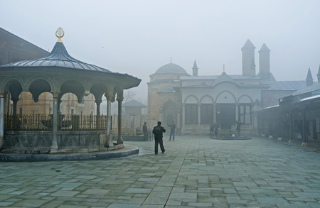 seljuk: KONYA, TURKEY - JANUARY 20, 2015: The foggy view of the courtyard of Mevlana Museum, on January 20 in Konya. Editorial