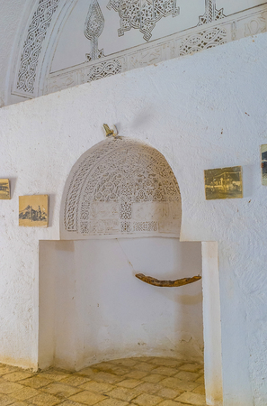ethnographic: EL KEF, TUNISIA - SEPTEMBER 5, 2015: The white plaster mihrab in building of the former mosque, serving as Ethnographic Museum, on September 5 in El Kef.