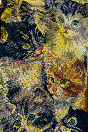 The cotton material decorated with beautiful cat pattern. Reklamní fotografie